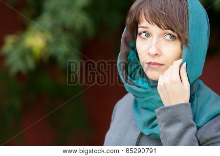 Woman With Sad Eyes In Scarf Outdoors
