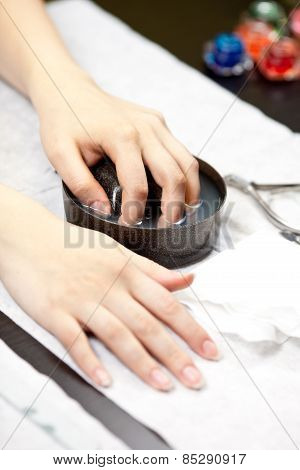 Woman At Manicure Procedure
