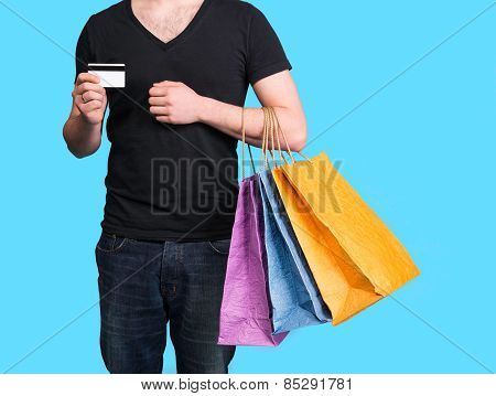 Young man with shopping bags and credit card