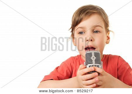 Pretty Little Girl In Red Sing In Old Style Microphone Isolated On White Background