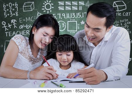 Family Doing Schoolwork In Class