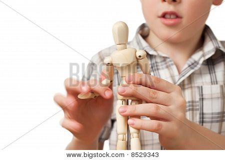 Boy In Checkered Shirt Is Played By Wooden Little Manikin Isolated On White Background
