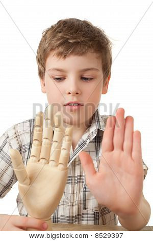 Boy Is Played By Wooden Hand Of Manikin Isolated On White Background, Two Palms