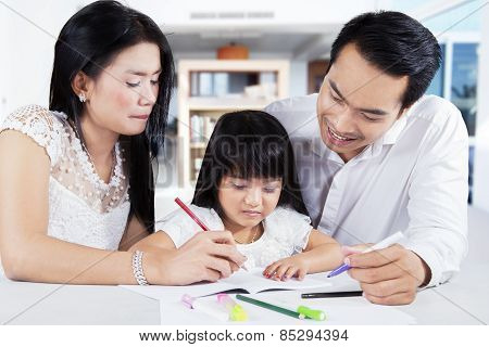 Girl Learn To Write With Parents