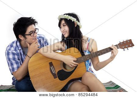 Girl Playing Guitar With Her Boyfriend