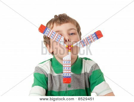 Boy In Striped T-shirt With Toy Propeller In Mouth  Isolated On White Background