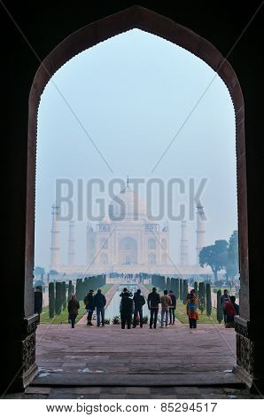 Crowd Of Tourists At Main Gate To Taj Mahal In The Fog Early Morning