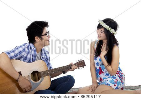Handsome Boy Plays Guitar To His Girlfriend