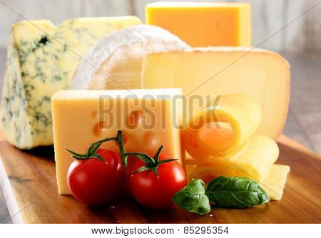Different Sorts Of Cheese Isolated On Kitchen Table