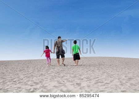 Happy Family Walk On Desert