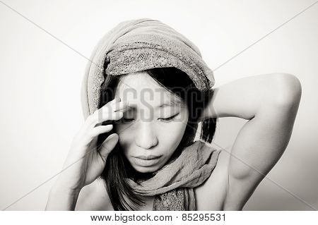 Young Asian Woman Close Up Looking Down Thinking