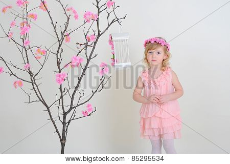 Sad Girl In A Pink Dress Against A Tree.