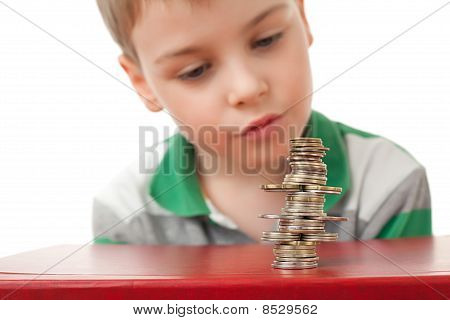 Boy In Striped T-shirt  Looking At Curve Pile From Coins Coins  Isolated On White Background