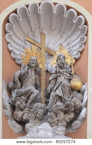 GRAZ, AUSTRIA - JANUARY 10, 2015: Holy Trinity on the portal of Dreifaltigkeitskirche ( Holy Trinity ) church in Graz, Styria, Austria on January 10, 2015.