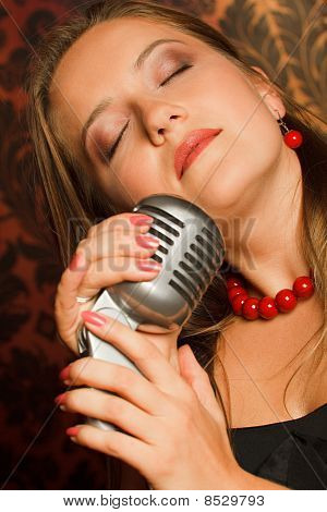 woman hugged her hands vintage microphone placed on a stand