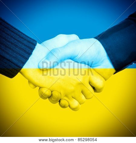 Handshake On Ukrainian Flag