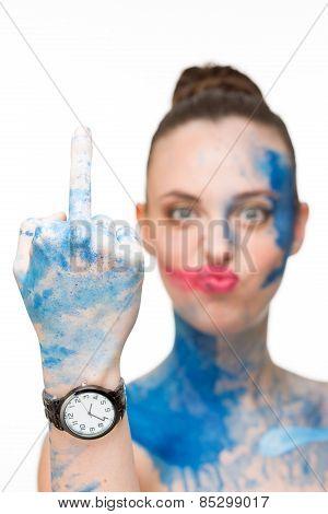 woman. make-up colour paint, showing middle finger