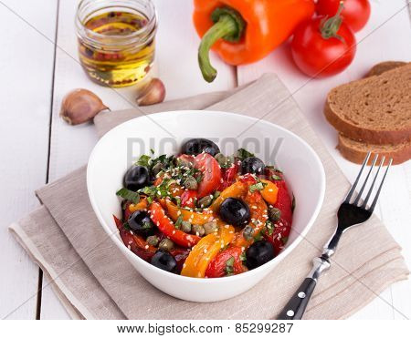Hot salad from roasted sweet pepper