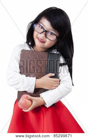 Pretty Child With Book And Apple