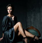 picture of up-skirt  - Young and beautiful fashion model over vintage and shabby background - JPG