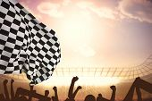 foto of crowd  - Checkered flag against football stadium with cheering crowd - JPG