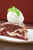 stock photo of ice-cake  - A slice of chocolate cake with ice cream - JPG