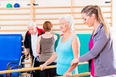 image of health center  - Seniors in physical rehabilitation therapy with trainer - JPG