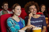 pic of cinema auditorium  - Young couple watching a film at the cinema - JPG