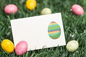 pic of laying eggs  - easter egg against blank greeting card with easter eggs - JPG