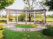 picture of gazebo  - Outdoor wooden gazebo in the park over summer landscape background - JPG