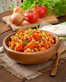 stock photo of lenten  - Stewed white beans and sliced pumpkin in tomato sauce - JPG