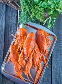 foto of creole  - boiled cancer on metal tray and on a table - JPG