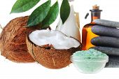 stock photo of massage oil  - Coconutsaltstones and massage oil for body close up - JPG