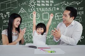 picture of applause  - Cheerful little girl get appreciation and applause from her parents after studying - JPG