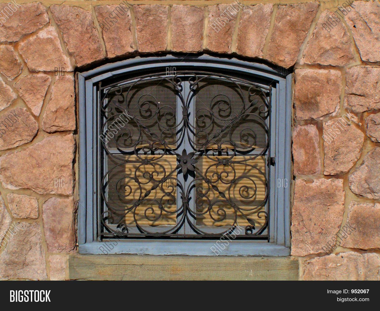 Decorative security grate over basement window stock photo