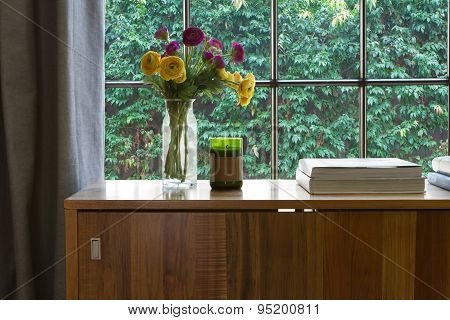 Warm Interior Looking Onto A Green Hedge Garden Outlook