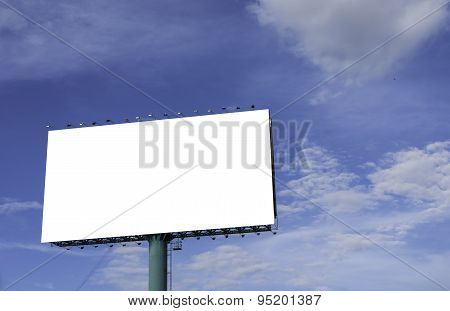 Advertisement Bill Board With Blue Sky In Background.