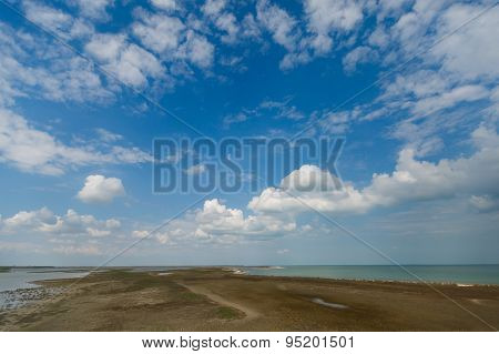 Sky and big clouds over firth with horizon line