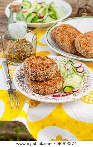 Potato And Pork Patties With Cucumber And Radish Salad