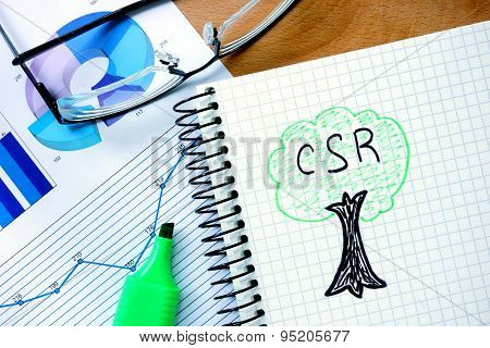 Notepad with csr  Corporate social responsibility.