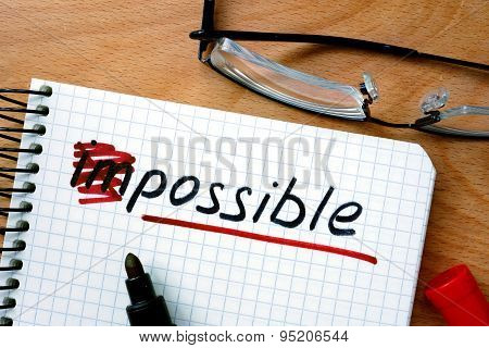 Notepad with converting the word impossible to possible.