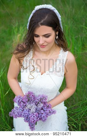 Beautiful Bride With Bouquet Of Lilac Flowers