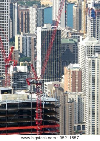 Chicago architecture and red construction cranes