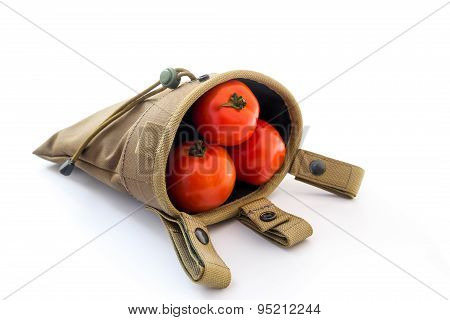 Dirty Red tomato in Magazine Drop Pouch on white background.