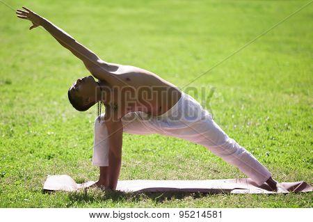 Yoga Pose Uthitta Parshvakonasana In Park