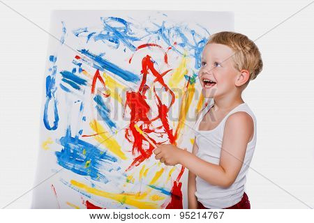 Little kid painting with paintbrush picture on easel. Education. Creativity