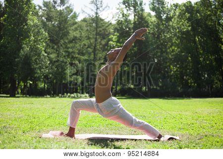 Crescent Yoga Pose In Park