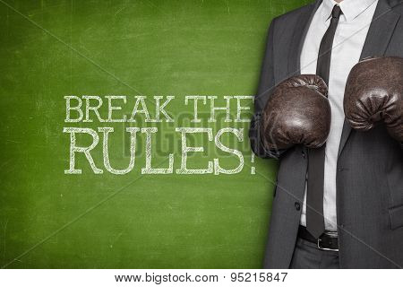 Break the rules on blackboard with businessman