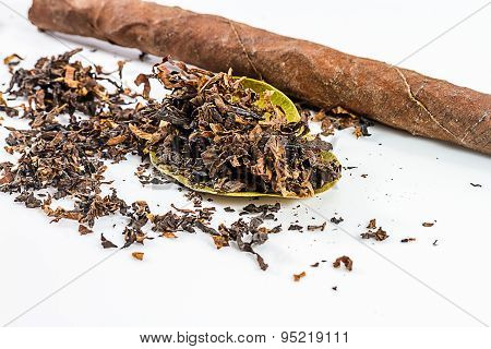 close-up of pile of tobacco on white table