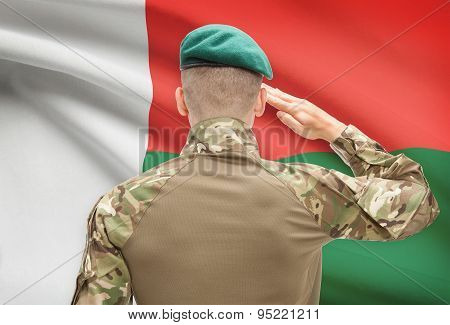 National Military Forces With Flag On Background Conceptual Series - Madagascar